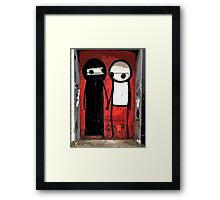 Street art by Stik in the Shoreditch area of London Framed Print