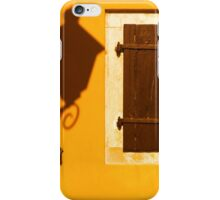 Street lamp shadow on a yellow wall. iPhone Case/Skin