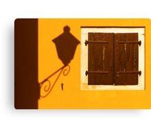 Street lamp shadow on a yellow wall. Canvas Print