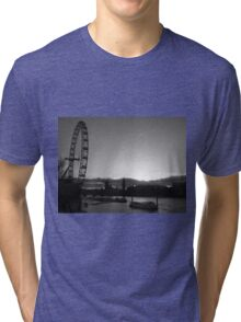 London...blink of a moment...caught it... Tri-blend T-Shirt