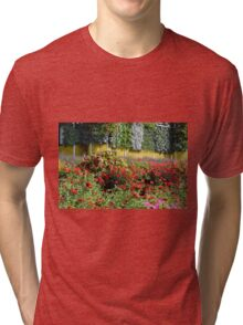Garden with many colorful flowers. Tri-blend T-Shirt