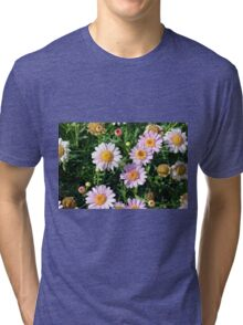 Beautiful light pink flowers natural background. Tri-blend T-Shirt
