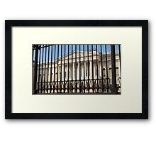 high iron fence in front of palace Framed Print