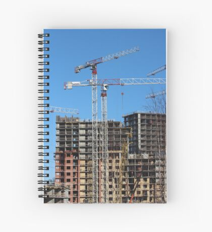 tower cranes on construction site Spiral Notebook