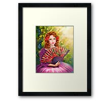Girl beautiful with a fan against a grape garden. Framed Print