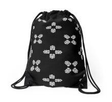 White ornament on black Drawstring Bag