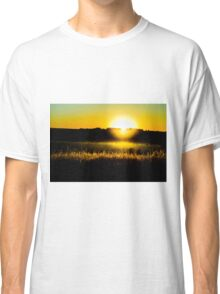 Yellow sunset behind barbed wire Classic T-Shirt