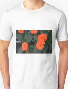 Orange flowers and green leaves bush. Unisex T-Shirt