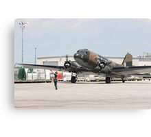 Two engines transport airplane Douglas DC-3 Dakota(C-47) the working hors of WWII on start line. Canvas Print