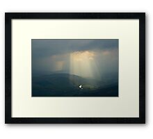 Sunbeams through clouds in the Scottish Highlands Framed Print