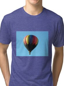 Hot air balloon floating in the air.  Tri-blend T-Shirt