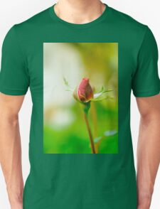 Perfect Red Rose bud with lush green background  T-Shirt