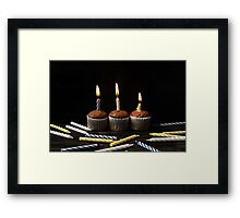 Little chocolate cupcakes with candles Framed Print