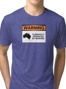 WARNING: CURRENTLY OPERATED BY MORONS Tri-blend T-Shirt