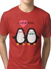 Love the penguins. Cute animals. Tri-blend T-Shirt
