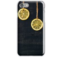 Lemon slices on the rope on a black background iPhone Case/Skin