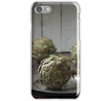 Artichokes in a rustic kitchen iPhone Case/Skin