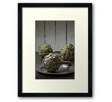 Artichokes in a rustic kitchen Framed Print