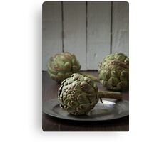 Artichokes in a rustic kitchen Canvas Print