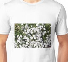 Many white small flowers in the grass. Unisex T-Shirt