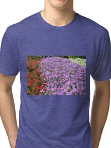 Rows of colorful flowers in the park. Tri-blend T-Shirt