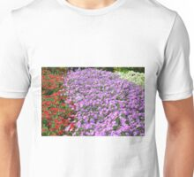 Rows of colorful flowers in the park. Unisex T-Shirt