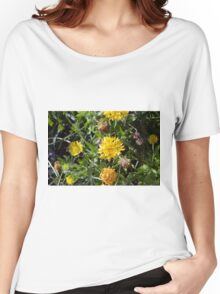 Yellow flowers in the green grass. Women's Relaxed Fit T-Shirt