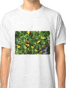 Yellow flowers in the green grass. Classic T-Shirt