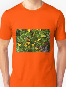 Yellow flowers in the green grass. Unisex T-Shirt