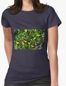 Yellow flowers in the green grass. Womens T-Shirt
