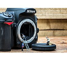 Cleaning a nikon camera Photographic Print