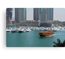 Photography of tall buildings, skyscrapers from Dubai and wooden boat crossing the water. United Arab Emirates. Canvas Print