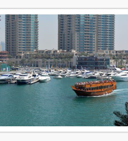 Photography of tall buildings, skyscrapers from Dubai and wooden boat crossing the water. United Arab Emirates. Sticker