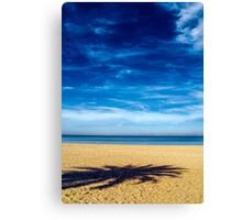 Solitude on empty beach Canvas Print