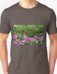 Beautiful colorful red and purple flowers in the garden. T-Shirt