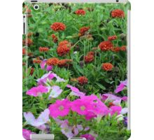 Beautiful colorful red and purple flowers in the garden. iPad Case/Skin