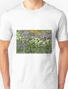 Many small flowers in the garden. Unisex T-Shirt