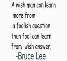 "A wish man can learn more from...""-Bruce Lee One Piece - Short Sleeve"