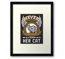 Never underestimate the Power of an Old Woman with her Cat Framed Print