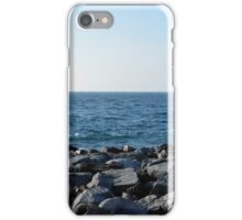 The sea and blue sky, and rocks at the shore. iPhone Case/Skin