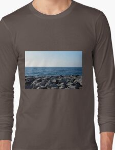 The sea and blue sky, and rocks at the shore. Long Sleeve T-Shirt