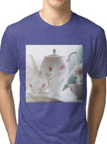 Hand painted china teapot, cup and saucer, with a flower. Tri-blend T-Shirt