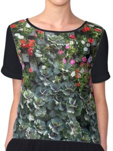 Natural background with small red flowers among green leaves. Chiffon Top