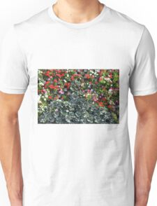 Natural background with small red flowers among green leaves. Unisex T-Shirt