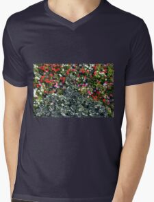 Natural background with small red flowers among green leaves. Mens V-Neck T-Shirt