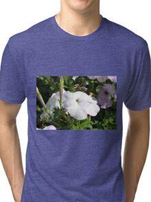 Beautiful light purple flowers in the garden. Tri-blend T-Shirt