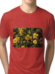 Many joyful yellow flowers in the garden. Tri-blend T-Shirt