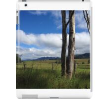 Tree trunks front the mountains iPad Case/Skin