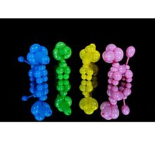 Colorful twisted balloon animal poodles on glass Photographic Print