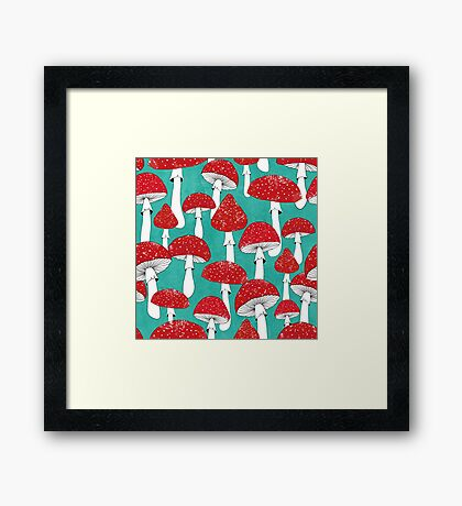 Red mushrooms on turquoise blue Framed Print